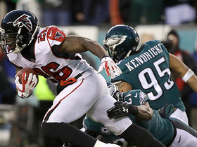 Tevin Coleman bounces off tacklers for 14 yards and a first down