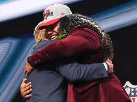 Watch: NFL first-round draftees hug it out with Roger Goodell