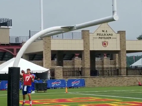 Watch: Josh Allen warms up by weaving passes between field goal uprights