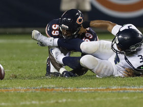 Watch: Russell Wilson fumbles ball in frenzy, Leonard Floyd recovers