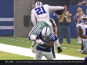 Watch: Can't-Miss Play: Zeke goes WAY UP to hurdle Desir for first down