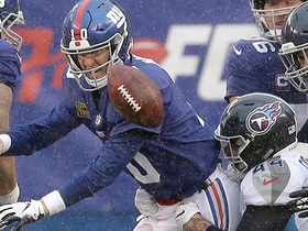 Watch: Eli's throw away attempt results in fumble, Titans recover