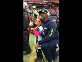 Watch: Russell Wilson signs kid's jersey before game