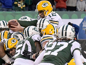 Watch: Rodgers reaches over pile for TD to take lead late