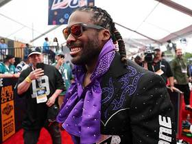 Watch: Williams, Wilfork rock wild outfits on draft red carpet