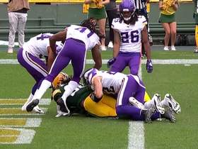 Watch: Jamaal Williams muscles through three Vikings defenders for the TD