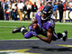Watch: Lamar Jackson evades the rush to deliver TD strike to Miles Boykin