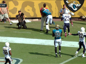 Justin Blackmon runs over sideline official