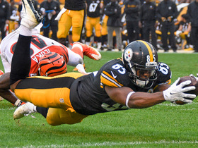 Xavier Grimble dives into the end zone for a 20-yard touchdown