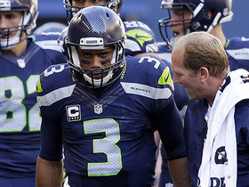 Russell Wilson suffers injury on tackle, returns to field