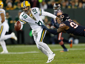 Rodgers avoids sack and throws ball away as spun down