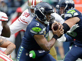 Russell Wilson scrarmbles out of pocket and picks up a first down