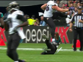 Nick Boyle hurdles over Jaguars defenders for 7-yard gain