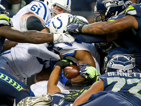 Robert Turbin pushes through defenders for a touchdown