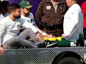 Aaron Rodgers goes to sideline after hit by Anthony Barr