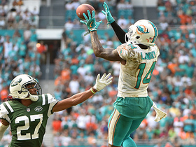 Jarvis Landry leaps and pulls down a 29-yarder into the red zone