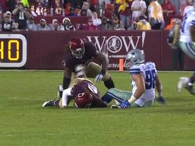 Demarcus Lawrence secures loose ball after Cousins is hit hard