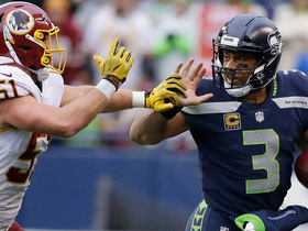 Russell Wilson stiff arms Will Compton to punctuate 11-yard run