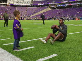 Stefon Diggs plays catch with young fan wearing his jersey