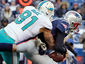 Brady picks up bobbled snap, but Wake wraps him up for sack