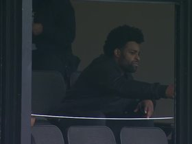 Michael Crabtree watches game from stands in third quarter