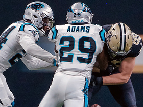 Mike Adams rips the ball from Josh Hill to force Saints' fumble
