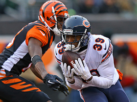 Eddie Jackson rips the ball away from A.J. Green, recovers it himself