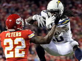 Melvin Gordon tries to hurdle Marcus Peters; it doesn't work