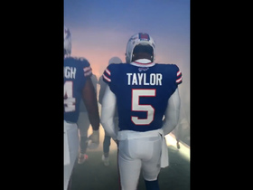 Tyrod Taylor leads the Bills out of the tunnel