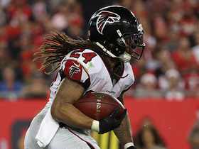 Devonta Freeman trucks Chris Conte to ground on powerful run