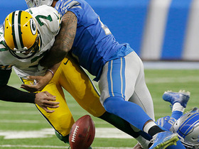 Glover Quin punches the ball from Brett Hundley to force fumble