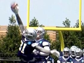 Byron Jones leaps up for one-handed INT at camp