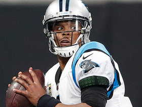 Cam avoids defenders, throws across his body to Funchess