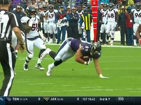 Andrews leaps over two Broncos defenders for first down
