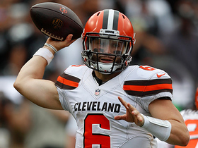 Baker Mayfield passes for first down after a near sack