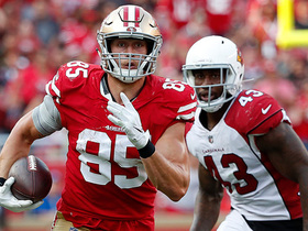 George Kittle swerves through defenders for a 45-yard gain