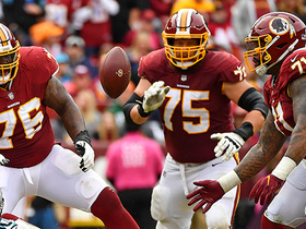 OT Trent Williams catches ball in mid-air after strip-sack on Alex Smith