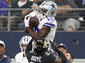 Michael Gallup holds on tight for a 27-yard gain