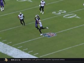 Crabtree somehow makes sideline catch after Flacco scramble