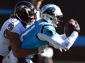 Captain Munnerlyn dives to intercept Flacco near turf