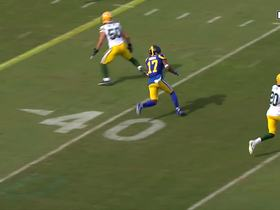 Woods secures strong pass over the middle for 15 yards