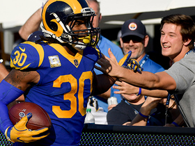 Gurley high-fives fans along end zone after TD