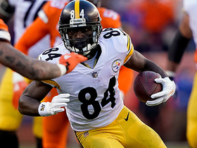 Antonio Brown fights through contact for first down
