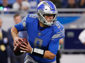 Matthew Stafford pitches a pass for a loss