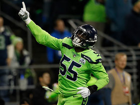 Frank Clark runs over Mike Remmers to sack Cousins
