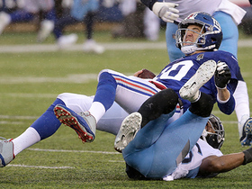 Titans pass rush gets through to sack Eli before half