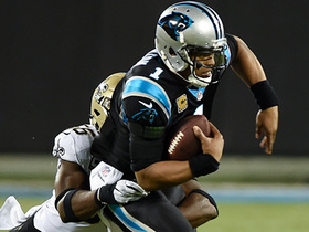 Davis flies in on the blitz to sack Newton