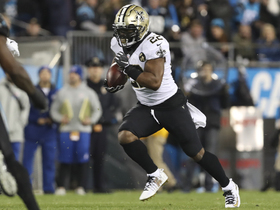 Mark Ingram trucks Eric Reid en route to 22-yard run
