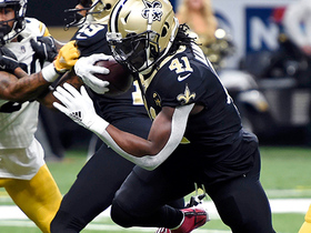Kamara shrugs off two would-be tacklers for walk-in TD
