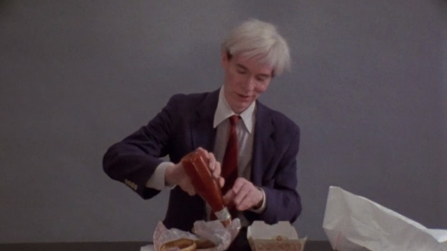 Watch Andy Warhol stoically eat Burger King